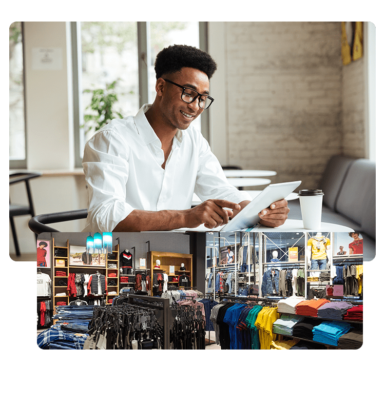 businessman looking happily at his laptop at sales on his clothing Anzili online shop